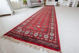 Kézi csomózású perzsa szőnyeg Buharai piros 120x585cm